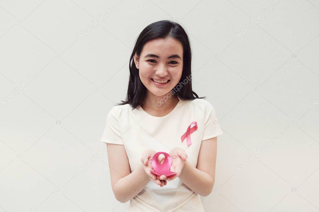 sites/74247825/depositphotos_218615978-stock-photo-asian-young-woman-holding-pink.jpeg